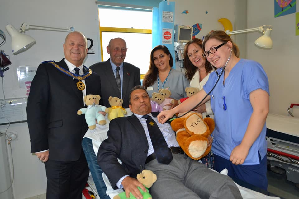 Freemasons and staff with teddies.